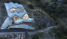 Spain cliff home - A multi-million  home sitting on the edge.  Design - Fabulous D.Martin