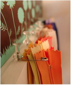 Use Safety & Push Pins to organize zippers or ribbon on a wooden board.
