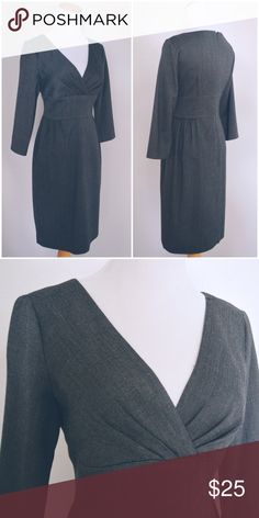 gray dress. form fitted dress with 3/4 sleeves. v neck and slit in back, fully lined. Maggy London Dresses