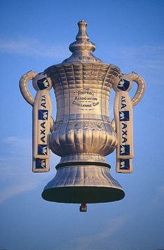The AXA FA Cup special shape balloon was a Cameron 90SS, G-OAXA, and was built in 2000. At the end of the contract in 2002 the sponsors insisted that the balloon was cut up and destroyed.