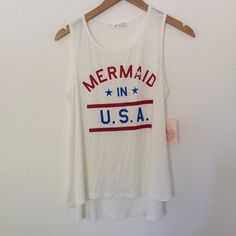 "Mermaid in the USA Tank ""Mermaid in USA"" tank top. Trapeze cut with a high low hem. Measurements for the Large size: 18"" pit to pit and 22"" to high hem 25"" to low hem. 97% rayon and 3% spandex so there is some stretch and it's super soft! PRICE FIRM Tops Tank Tops"