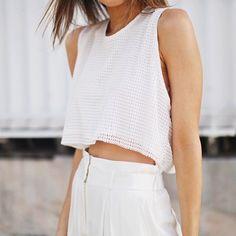 White crop top, white pants.