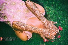 Beautiful bridal mehendi with intricate patterns.