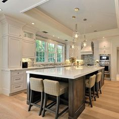 There is no question that designing a new kitchen layout for a large kitchen is much easier than for a small kitchen. A large kitchen provides a designer with adequate space to incorporate many convenient kitchen accessories such as wall ovens, raised. Kitchen Island With Seating For 4, Kitchen Island With Sink, Farmhouse Kitchen Island, Kitchen Island Decor, Big Kitchen, Home Decor Kitchen, Kitchen Ideas, Kitchen Islands, Island Bar