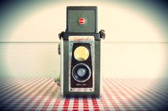 Vintage Refurbished 195560 Brown Kodak Duaflex by AbrahamAndMarie on Etsy.This 620 camera is FULLY CAPABLE OF SHOOTING 120 FILM; In fact, we're throwing in a vintage 620 take-up spool to get you started. The only catch... You have to P R O M I S E to shoot this beautiful piece of photography history! We gladly offer tech support too!    (SOLD)