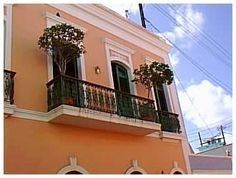 I want to live here...cool balcony overlooking Old San Juan street