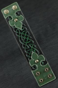 "Celtic Clover LeatherCuff 2""wide). Intricate tooling and airbrushing highlight the filigreed knot-work design by Chad Little at EthosCustomBrands on Etsy"