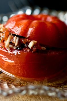 NYT Cooking: Stuffed tomatoes are ubiquitous in Greece. They're filled with rice and herbs, usually mint and dill, with a little shredded zucchini mixed in with the rice. I'm giving you the choice of bulgur or rice. If you can't tolerate gluten, use the rice; if you can and prefer a whole grain, use the bulgur.