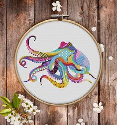 This is modern cross-stitch pattern of Mandala Octopus for instant download. You will get 7-pages PDF file, which includes: - main picture for your reference; - colorful scheme for cross-stitch; - list of DMC thread colors (instruction and key section); - list of calculated