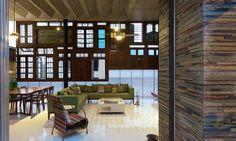 La façade créative permet de jouer et colorer la lumière du soleil dans le salon
