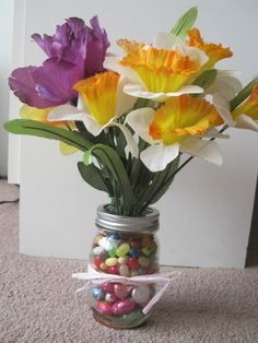 Spring table cedoration. Mason jar filled with candy. Lid taped on bottom.