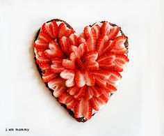 Brownie w/frosting & strawberries for Valentine's- yum! Also a cute way to cut the strawberries for kids.