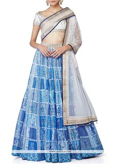 You will be the center of attention in this attire. Keep ahead in fashion with this blue and white raw silk designer lehenga choli. This lovely attire is looking extra beautiful with embelishment of l...