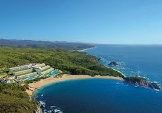This stunning aerial shot captures Secrets Huatulco with the surrounding Sierra Madre Mountains and coastline of the Conejos Bay. #UnlimitedVacationClub