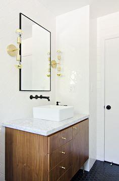 Sleek bathroom design with glossy wooden vanity and square sink | The Vintage Rug Shop