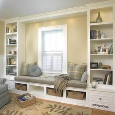 I love a window seat surrounded by book shelves. This reminds me of the room I grew up in.