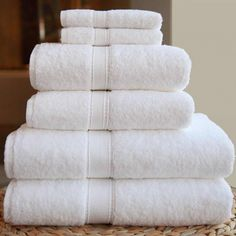 Keep White Towels White:  No more dingy! 1. Add regular detergent as usual.  2.Fill the fabric softener cup with vinegar.  3. Fill bleach cup with hydrogen peroxide.   This will only work for brand new towels to keep them from getting dingy.  I have no idea how to get dingy out once it's already set in,  I have had the same bright white towels for 4 years!