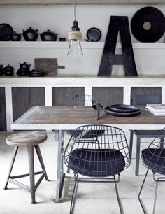 METROPOLITAN style         metropolitan /  black wire chairs / large mongram cool pendant light