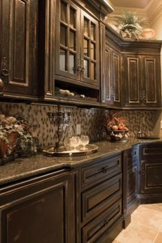 Distressed, coffee colored kitchen cabinets.