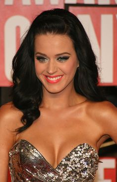 katy perry. she followed her dreams and is successful by being her crazy, wacky self(: