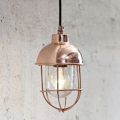 fab little copper ceiling pendant with glass dome and copper caging Dimensions 15cm Diam x 23cm H  From Uniche Interior furnishings £75