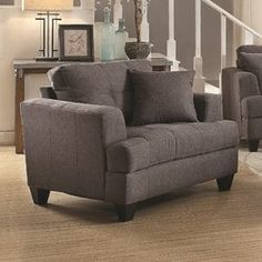 Whether you love to lounge with lots of elbow room as you flip through magazines or you can't resist inviting your furry friend onto your lap as you watch TV, this charming chair and a half gives you space to spread out. Featuring classic track arms and tufted upholstery, this timeless piece complements any chic ensemble. Set this solid-hued stunner next to a streamlined linen sofa for an understated seating arrangement, then pile patterned pillows onto its fabric cushions to give your sp...