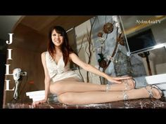 Hot Asian girl wearing a short skirt and nylon pantyhose showing her sexy legs and feet