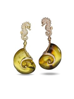 Carved amber earrings.massimo izzo