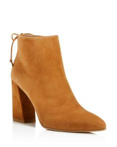 Minimal in construction, Stuart Weitzman streamlines the season's '70s trend in these suede pointed-toe booties with a back lace-up accent and a unique flared heel. | Suede upper, leather lining, leat