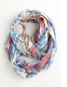 "This fun southwestern scarf is called the ""Desert at Dusk Scarf."" While giving your outfit fun color, this  infinity scarf also brings a lot of versatility. It's now on sale for $9.99!"