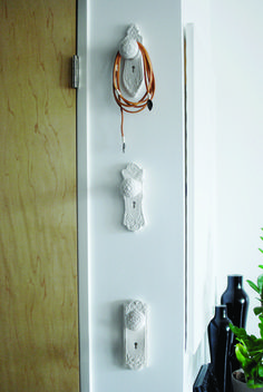 DIY - use old door knobs for wall hooks. Paint any color. I kinda like this idea for the hooks in my mudroom.