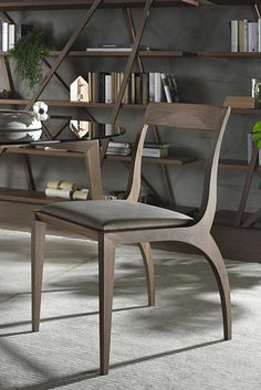 Thelma chairs by Pacini & Cappellini in solid canaletto walnut. Seat in leather, eco-leather or fabric.