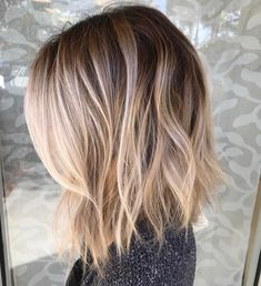 Beautiful smudged, blended balayage with the most perfect root fading into blonde. Love these beach waves and this lob haircut to further flatter this gorgeous color technique.