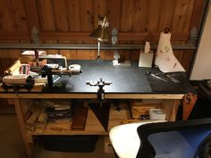 This is one of Ronnie's workbenches.  Leather pieces are cut, and rawhide lace is prepared for braiding at this table.