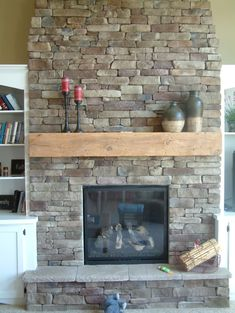 Furniture: Enchanting Fireplace Mantels Decorating Ideas, Awesome Glass Fireplace with Stone Wall Exposed and Minimalist Wood Rack Mantel De...
