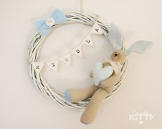 Lovely bunny on a willow wreath for decoration - Bunny wreath by  Federica Baricolo