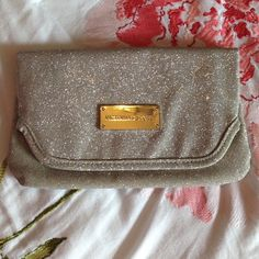 NWOT Victoria's Secret Clutch Super cute glittery clutch. It has tiny scratches on the metal sort in pic 2 but it's not noticeable. It's new Victoria's Secret Other