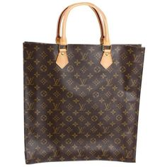 Louis Vuitton monogrammed Sac Plat handbag, model MI 1020, likely dates to the mid-1990's and is made of canvas with leather handles and gold-toned hardware. Bag is unused and comes with original dust
