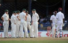 Australian cricket team (L) waits for ruling on appeal for lbw against West Indies batsman Kraigg Brathwaite (R) with teammate Adrian Barath (2nd R) during the second day of the second-of-three Test matches between Australia and West Indies April 16, 2012 at Queen's Park Oval in Port of Spain, Trinidad. Australia got the appeal.