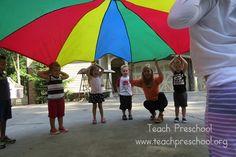 Parachute basics: The hello game – Teach Preschool Preschool Music Activities, Body Preschool, Gross Motor Activities, Movement Activities, Teach Preschool, Preschool Classroom, Preschool Ideas, Infant Activities, Physical Activities