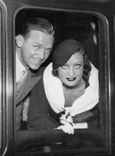 US-american actress Joan Crawford and her husband Douglas Fairbanks jr. at their depature from London/Viktoria Station. Die US-amerikanische Schauspielerin Joan Crawford. Get premium, high resolution news photos at Getty Images Old Hollywood Stars, Old Hollywood Glamour, Golden Age Of Hollywood, Vintage Hollywood, Classic Hollywood, Hollywood Couples, Classic Movie Stars, Classic Movies, Douglas Fairbanks