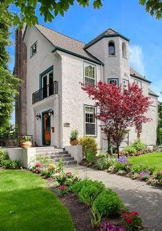 Towering 4-story Madrona mansion for sale  romances like grande French chateau; 4810 sq ft, 5 beds/3.75 ba. Fully renovated in 2004 from studs out of 1911 manor. Sweeping Lake Wash-Bellev-Cascade views. Huge 9000 sf corner lot. Sun-kissed light-filled rooms. High-grade chef's kit w/ss app, bright nook. Fire blazes in liv rm, din rm w/entertainment deck. Lower level bonus, rec rm. Opulent master penthouse suite w/view deck, spa-like bath w/chandelier. Near shops/eateries, min to Seattle.