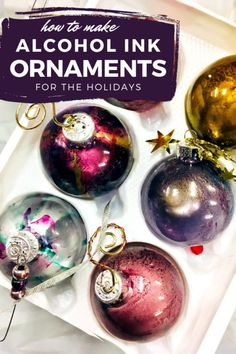 DIY alcohol ink ornaments! Alcohol ink ornaments are a beautiful way to decorate your Christmas tree or winter wreath for your Christmas decor this holiday season. They're quick and easy to make. Learn how to make these DIY alcohol ink ornaments for your winter Christmas decorations for the holidays. Plus a video tutorial on how to make DIY alcohol ink ornaments as an easy winter crafts ideas. Craft your own DIY Christmas decorations for the holidays.