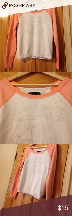 American Eagle Sweatshirt Pre owned used condition. Size medium. Made in Vietnam.  Not perfect, slight imperfections noted. Material looks to be in good shape.  Peach and off white color. Very soft to touch. American Eagle Outfitters Tops Sweatshirts & Hoodies