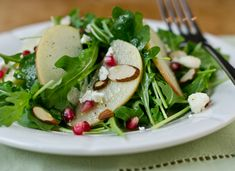 Arugula, Apple, and Pomegranate Salad with Cider-Honey Vinaigrette Recipe | Serious Eats