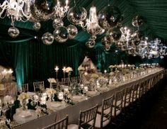 A gorgeous dinner party in a rich emerald green tent, designed with glistening mirrored tabletops, white amaryllis blossoms, candle light and a plethora of mirrored balls and crystal chandeliers undulating in abundance as an incredible ceiling installation!