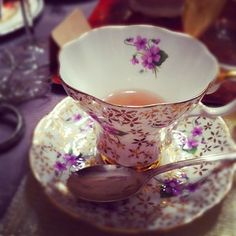 pretty china cup at a high noon tea party