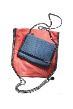 Stella McCartney and the Art of the Nonleather Goods: Polyurethane Falabella tote and textured polyurethane purse, resort 2013.