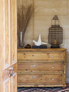 love the antique pine dresser + details; wire lantern; door; rug
