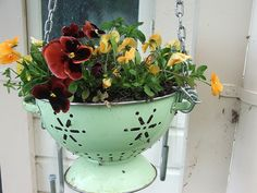 Not much of a cook? Turn your dusty kitchen colander into a hanging planter with a little chain. Best part? The drainage holes are built in!